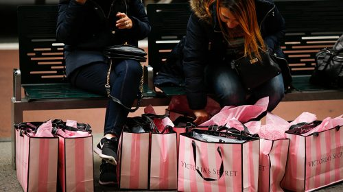 NEW YORK, NY - NOVEMBER 25:  Women rest next to Victoria Secret shopping bags during Black Friday events on November 25, 2016 in New York City.  The day after Thanksgiving, called Black Friday, is typically the biggest shopping day of the year in the United States. (Photo by Eduardo Munoz Alvarez/Getty Images)